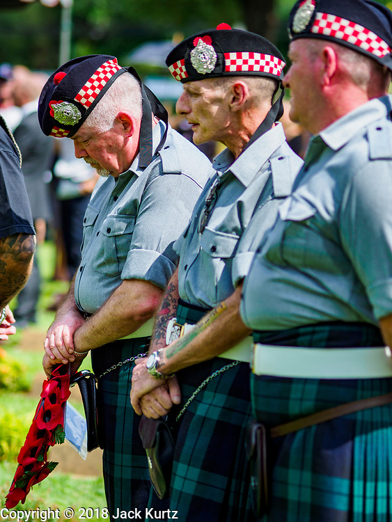 """11 NOVEMBER 2018 - KANCHANABURI, KANCHANABURI, THAILAND: Scottish veterans of the British army during the Rememberance Day ceremony at the Kanchanaburi War Cemetery in Kanchanaburi, Thailand. Kanchanaburi is the location of the infamous """"Bridge On the River Kwai"""" and was known for the """"Death Railway"""" built by Japan during World War II using allied, principally British, Australian and Dutch, prisoners of war as slave labor. There are 6,982 people buried in the cemetery, including 5,000 Commonwealth soldiers and 1,800 Dutch soldiers. November 11, 2018 marked the 100th anniversary of the end of World War I, celebrated as Rememberance Day in the UK and the Commonwealth and Veterans' Day in the US.    PHOTO BY JACK KURTZ"""