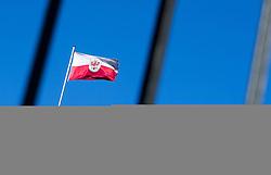 THEMENBILD - Landhausplatz Innsbruck, im Bild die Tiroler Landesflagge, gesehen durch Gitterstaebe am Befreiungsdenkmal, Bild aufgenommen am 24.02.2014. EXPA Pictures © 2014, PhotoCredit: EXPA/ JFK