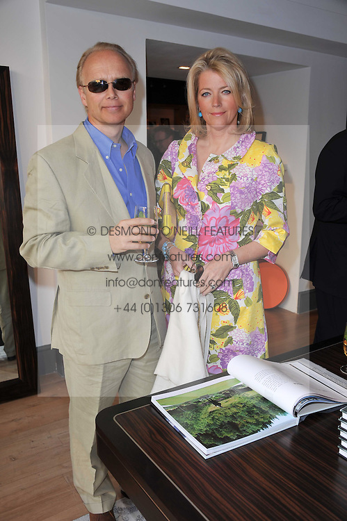 PAUL & HELEN PHEYSEY  at a party to celebrate the publication of 'Garden' by Randle Siddeley held at Linley, 60 Pimlico Road, London on 24th May 2011.