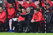 Manchester United manager Jose Mourinho doing hand gestures while sitting in the dug out during the Premier League match between Bournemouth and Manchester United at the Vitality Stadium, Bournemouth, England on 3 November 2018.