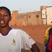 Traoré Djenema (on the left), center forward of Amazones, is talking about football; she would like to become a professional star