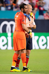 July 28, 2018 - Miami Gardens, FL, U.S. - MIAMI GARDENS, FL - JULY 28: Manchester City's goalkeeper Claudio Bravo (1) hugs Bayern Munich's Arjen Robben after the International Champions Cup game between FC Bayern Munich and Manchester City FC on July 28, 2018 at the Hard Rock Stadium in Miami Gardens, Florida. (Photo by Doug Murray/Icon Sportswire) (Credit Image: © Doug Murray/Icon SMI via ZUMA Press)