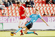 Fleetwood Town defender Ashley Eastham (5) gets a slide tackle in on Charlton Athletic forward Tony Watt (7) during the EFL Sky Bet League 1 match between Charlton Athletic and Fleetwood Town at The Valley, London, England on 4 February 2017. Photo by Andy Walter.