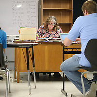 Tupelo Middle School teacher Eileen Bailey begins working on seventh grade lesson plans for the next school with other teachers Tuesday morning.