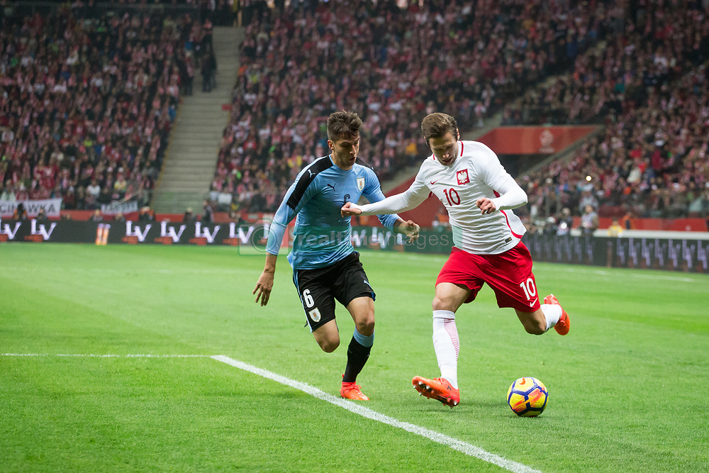 November 10, 2017 - Warsaw, Poland - Rodrigo Bentancur (U6) vies Grzegorz Krychowiak (P10) during the international friendly soccer match between Poland and Uruguay at the PGE National Stadium in Warsaw, Poland on 10 November 2017  (Credit Image: © Mateusz Wlodarczyk/NurPhoto via ZUMA Press)