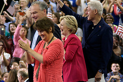 Philadelphia, Pennsylvania, USA - July 29, 2016; Democratic presidential nominee former Secretary of State Hillary Clinton, joined by her husband former U.S. President Bill Clinton and Democratic vice presidential nominee U.S. Sen. Tim Kaine, with his wife Anne Holton on stage at a Post-DNC campaign rally at Temple University in Philadelphia, Pennsylvania,