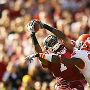 South Carolina's Moe Brown hauls in a pass from Stephon Gilmore over Clemson's Chris Chancellor during first-quarter action in Columbia, S.C. on Saturday, Nov. 28, 2009. The catch was a part of drive that led to a Gamecock touchdown. (Travis Bell/Sideline Carolina)