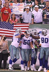 Sept 11, 2011; East Rutherford, NJ, USA;  The Dallas Cowboys celebrate an interception return by Dallas Cowboys linebacker Sean Lee (50) during the second half at the MetLife Stadium. The Jets defeated the Cowboys 27-24.
