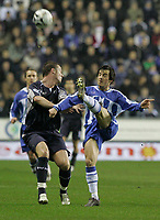 Photo: Dave Howarth.<br /> Wigan Athletic v Bolton Wanderers. Carling Cup.<br /> 20/12/2005.  Bolton's Garry Speed battles with Wigan's Leighton Baines