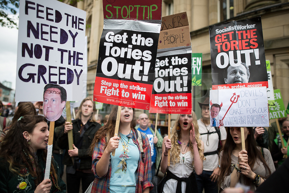 """© Licensed to London News Pictures . 23/05/2015 . Manchester , UK . A group of protesters peel away from the Piccadilly Gardens and march impromptu through St Anne's Square . A demonstration , organised by """" The People's Assembly """" , against austerity in Piccadilly Gardens in Central Manchester , attended by approximately 2000 people . Photo credit : Joel Goodman/LNP"""