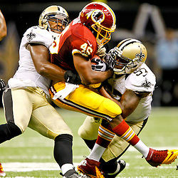 September 9, 2012; New Orleans, LA, USA; New Orleans Saints linebacker Curtis Lofton (50) and linebacker David Hawthorne (57) tackle Washington Redskins running back Alfred Morris (46) during the second half of a game at the Mercedes-Benz Superdome. The Redskins defeated the Saints 40-32. Mandatory Credit: Derick E. Hingle-US PRESSWIRE
