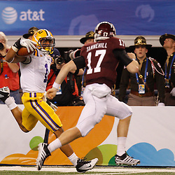 Jan 7, 2011; Arlington, TX, USA; LSU Tigers cornerback Eric Reid (1) runs  back an interception as Texas A&M Aggies quarterback Ryan Tannehill (17) pursues during the second quarter of the 2011 Cotton Bowl at Cowboys Stadium.  Mandatory Credit: Derick E. Hingle