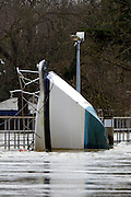 ***TODAY PICTURE***© Licensed to London News Pictures. 12/02/2014. Old Windsor, UK . A boat wedged against Bell Weir. Flooding in OLD WINDSOR in Surrey today 12th February 2014 after the River Thames burst its banks. The Environment Agency has issued 14 Severe Flood Warnings alone the Thames. Photo credit : Stephen Simpson/LNP