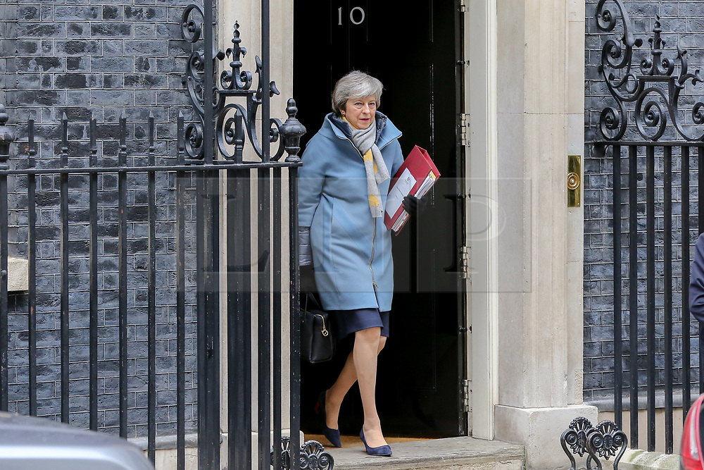 © Licensed to London News Pictures. 13/03/2019. London, UK. Britain's Prime Minister Theresa May leaves No 10 Downing Street for House of Commons for Prime Minister's Questions and the Chancellor of the Exchequer Phillip Hammond will announce the state of the British economy in his Spring Statement to the Parliament. Photo credit: Dinendra Haria/LNP