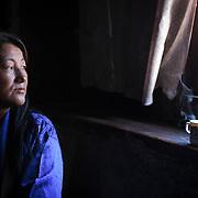 A Bhutanese woman in a coffee shop, Trongsa Town, Bhutan, Asia