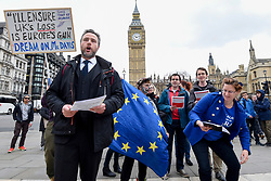 "© Licensed to London News Pictures. 29/03/2017. London, UK. Pro-Europe demonstrators stage a protest, led by (second L) Simon Wallfisch, an opera baritone who performs Europe-wide.  The protestors paraded around Parliament Square singing the European Union anthem, ""Ode to Joy"".  Today, is the day that Article 50 is formally triggered, with a handwritten letter bearing the Prime Minister's signature being delivered to the European Union today. Photo credit : Stephen Chung/LNP"