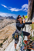 Climber on Cathedral Peak, Tuolumne Meadows area, Yosemite National Park, California USA