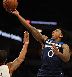 October 19, 2018 - Minneapolis, MN, USA - The Minnesota Timberwolves' Jeff Teague (0) lifts a shot over the Cleveland Cavaliers' George Hill in the first half on Friday, Oct. 19, 2018, at the Target Center in Minneapolis. (Credit Image: © Anthony Souffle/Minneapolis Star Tribune/TNS via ZUMA Wire)