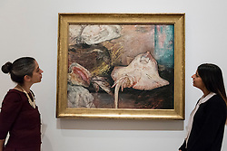 "© Licensed to London News Pictures. 25/10/2016. London, UK.  Staff members view ""The Skate, 1892"" at the preview of Intrigue: James Ensor by Luc Tuymans.  Curated by fellow Belgian artist Luc Tuymans, this is the first exhibition of work by modernist artist James Ensor (1860-1949) to be held in the UK in twenty years and will run 29 October 2016 to 29 January 2017. Photo credit : Stephen Chung/LNP"