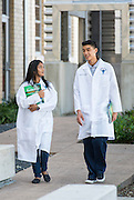 Jane Long Futures Academy students Kinza Rizwan, left, and Estanislado Sandoval III, right, pose for a photograph at the Houston Community College Coleman College for Health Sciences pharmacy technology labs, October 16, 2014.