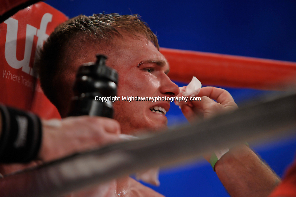 Nick Blackwell in corner with curt and bloody nose. He went onto defeat Nathan King in a middleweight boxing contest at Glow, Bluewater, Kent on the 8th November 2014. Promoter: Hennessy Sports. © Leigh Dawney Photography 2014.