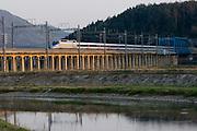 Railway bridge near Baegyangsa. A KTX (Korea Train Express) high speed train (a license of French TGV) going from Seoul to Gwangju.