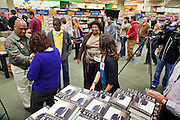 "09 DECEMBER 2010 - PHOENIX, AZ: Workers hand out copies of George W. Bush's new book, ""Decision Points"" at the Barnes & Noble Bookstore in Phoenix, AZ, Thursday, Dec. 9. More than 2,000 people lined up starting at 5AM to get copies of the former President's book, ""Decision Points."" A handful of protesters demonstrated against President Bush near the bookstore, calling him a ""war criminal.""  PHOTO BY JACK KURTZ"