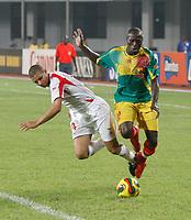 Photo: Steve Bond/Richard Lane Photography.<br />Mali v Benin. Africa Cup of Nations. 21/01/2008. Souleymane Dembele, (R) brushes aside Alain Gaspoz (L)