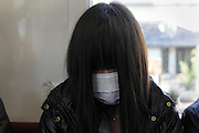 portrait of Asian school girl with mask during a commuting nap