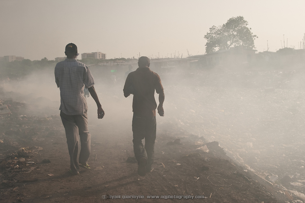 Imoro Toyibu (right) and Fuseini Alhassan of the Old Fadama Development Association walk past a smoking garbage dump that sits on the bank of the unbelievably polluted Odaw River in Old Fadama. Colloquially referred to as 'Sodom and Gomorrah, Old Fadama is located in Ghana's capital Accra and is home to some some 80,000 people.