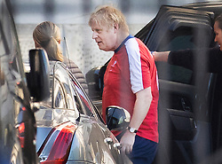 © Licensed to London News Pictures. 26/05/2020. London, UK. British Prime Minister Boris Johnson is seen in his running kit as he returns to Downing Street after going for a run at Buckingham Palace. The Prime Minister is under pressure over his backing for his senior advisor Dominic Cummings after it emerged that he had broken lockdown rules to drive his family to the northeast 260 miles away. Photo credit: Peter Macdiarmid/LNP