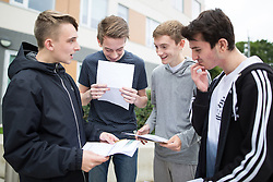 © Licensed to London News Pictures . 20/08/2015 . Salford , UK . LUKE KAVANAGH , CHRISTOPHER BIELIUNAS , CHRISTOPHER ELLIOTT and LEIGHTON KAHRAMAN look at their results . Students at St Patrick's RC High School in Eccles collect their GCSE results . Photo credit : Joel Goodman/LNP