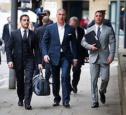 © London News Pictures. 02/05/2013. London, UK. Property tycoon Andreas Panayiotou (centre) arriving at Southwark Crown Court with his sons Costas Panayiotou (left) and George Panayiotou (right). George and Costas Panayiotou received a a 15-month sentence suspended for 18 months for an attack on two off-duty policemen on a night out, which left of the off-duty officers one needing titanium plates in his cheek and eye socket. Photo credit: Ben Cawthra/LNP<br /> <br /> Read more: http://www.dailymail.co.uk/news/article-2618831/Judge-blasts-sons-one-Britains-richest-tycoons-cowardly-vicious-attack-left-police-officer-needing-titanium-plates-lets-walk-FREE-court.html#ixzz30a8skGmd <br /> Follow us: @MailOnline on Twitter | DailyMail on Facebook<br /> <br /> Read more: http://www.dailymail.co.uk/news/article-2618831/Judge-blasts-sons-one-Britains-richest-tycoons-cowardly-vicious-attack-left-police-officer-needing-titanium-plates-lets-walk-FREE-court.html#ixzz30a7aQ300 <br /> Follow us: @MailOnline on Twitter | DailyMail on Facebook. Photo credit: Ben Cawthra/LNP