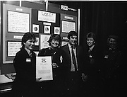11/01/1985.01/11/1985.11th January 1985.The Aer Lingus Young Scientist Exhibition at the RDS Dublin ..Elaine O'Reilly (left) and Clodagh O'Herlihy (fourth from left) both of the Loretto Abbey, Dalkey, Co. Dublin showing their Exhibit 'Work, The Housewife's Flexible Friend' to Gemma Hussey, T.D. (second from left) Minister for Education and George Birmingham, T.D. Minister of State at the Department of Labour during their visit to the stands. Also pictured is Aer Lingus Hostess Sally Ann Flanagan.