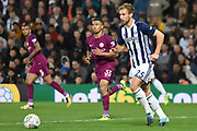 West Bromwich Albion defender Craig Dawson (25) keeps his composure on the ball 1-1 during the EFL Cup match between West Bromwich Albion and Manchester City at The Hawthorns, West Bromwich, England on 20 September 2017. Photo by Alan Franklin.