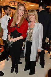 Left to right, DAISY DUNN and INGRID SEWARD at a party to celebrate the publication of 'A Designer's Life' by Nicky Haslam held at Ralph Lauren, 1 New Bond Street, London on 19th November 2014.