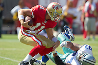 18 September 2011: Quarterback (11) Alex Smith of the San Francisco 49ers is sacked by (97) Jason Hatcher of the Dallas Cowboys during the first half of the Cowboys 27-24 overtime victory against the 49ers in an NFL football game at Candlestick Park in San Francisco, CA