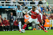 Alexandre Lacazette (#9) of Arsenal steps in to win the ball from Mohamed Diame (#10) of Newcastle United during the Premier League match between Newcastle United and Arsenal at St. James's Park, Newcastle, England on 15 September 2018.