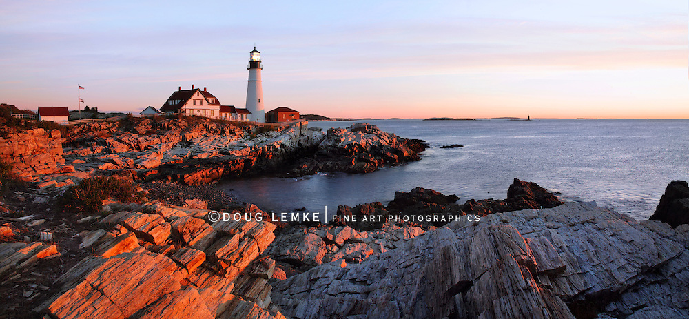 The First Light Of Dawn At The Portland Head Light, A Classic New England Lighthouse, Portland Maine, USA
