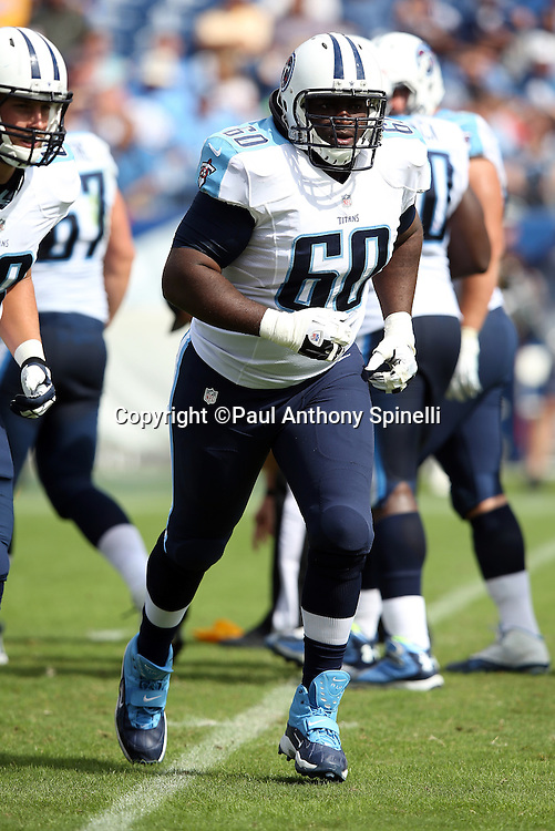 Tennessee Titans center Chris Spencer (60) jogs off the field during the NFL week 6 regular season football game against the Jacksonville Jaguars on Sunday, Oct. 12, 2014 in Nashville, Tenn. The Titans won the game 16-14. ©Paul Anthony Spinelli