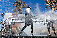 PORTUGAL, Cascais. 7th August 2011. America's Cup World Series. Day 2. L-R, Russell Coutts, Dean Barker and Terry Hutchinson celebrate during the first weekend series prizegiving.
