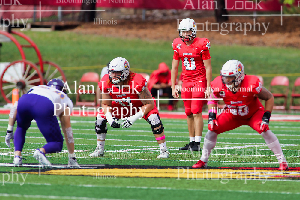 NORMAL, IL - October 06:  JT Bohlken prepares to punt behind linesmen Cole Anderson and Ty Deforest during a college football game between the ISU (Illinois State University) Redbirds and the Western Illinois Leathernecks on October 06 2018 at Hancock Stadium in Normal, IL. (Photo by Alan Look)