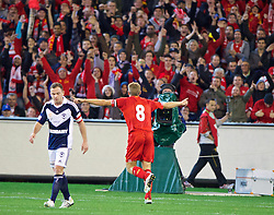 MELBOURNE, AUSTRALIA - Wednesday, July 24, 2013: Liverpool's captain Steven Gerrard celebrates scoring the first goal against Melbourne Victory during a preseason friendly match at the Melbourne Cricket Ground. (Pic by David Rawcliffe/Propaganda)