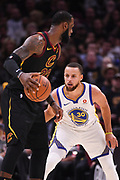 Jun 8, 2018; Cleveland, OH, USA; Cleveland Cavaliers forward LeBron James (23) handles the ball against Golden State Warriors guard Stephen Curry (30) during the second quarter in game four of the 2018 NBA Finals at Quicken Loans Arena.