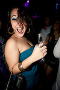 ASIAN GIRL IN GREEN DRESS SHOUTING HOLDING BEER BOTTLE CLEAVEGE