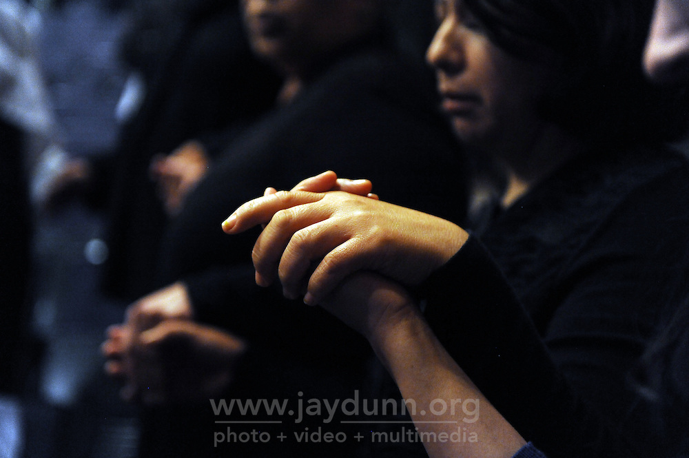 """Hands raised in prayer at the second """"Maria La Luz Divina"""" Congress on Sunday at Sherwood Hall. The well-attended, all-day event is sponsored by the Catholic Diocese of Monterey, and helps raise funds to keep radio programs at 1570 AM on the air."""