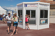 MONACO, MONACO - JUNE 17, 2015: Unidentified people get maps and directions at the office of tourism booth in Monaco.