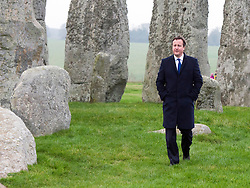 © Licensed to London News Pictures. 01/12/2014. Wiltshire, UK British Prime Minister David Cameron visits Stonehenge today 1st December 2014. A tunnel passing Stonehenge is among dozens of new road schemes announced by the government, as part of £15bn of improvements to England's roads. Photo credit : Stephen Simpson/LNP