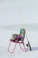 Middletown, New York - A fishing road and a girl's chair on the ice at the Shawangunk Fish and Game Association pond during the association's annual contest on Feb. 8, 2014. ©Tom Bushey / The Image Works