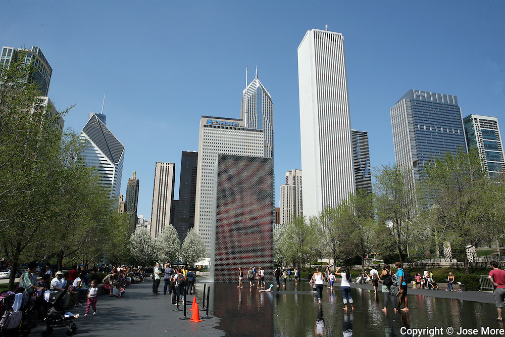 The interactive Crown Fountain is featured in Chicago's Millenium Park located off Michigan Avenue in the Loop community. The black granite reflecting pool was designed by Catalan artist Jaume Plenza and opened in July 2004. The towers are 50 feet tall, using  LEDs to display digital videos on their inward faces.<br /> <br /> Jose More Photography
